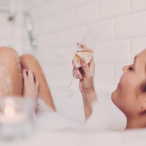 women in the tub with wine
