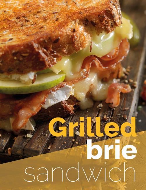 grilled brie sandwich op plank